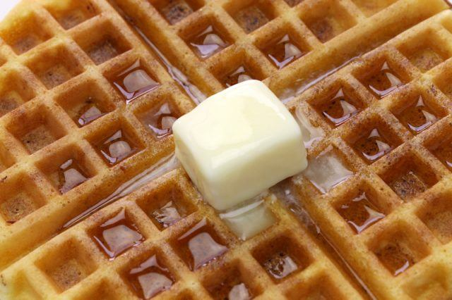 A waffle with syrup and butter.