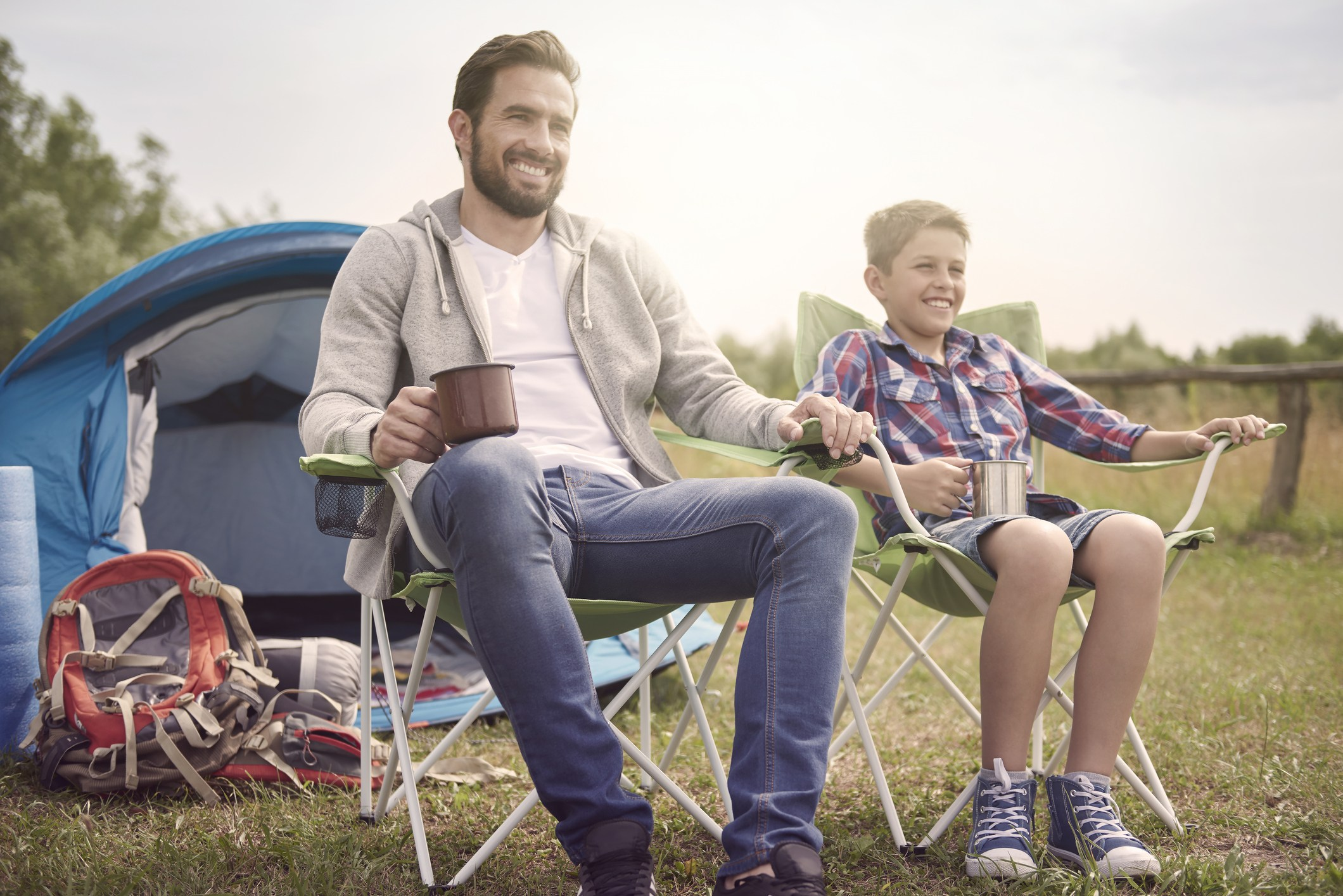 Father and son in camping chairs