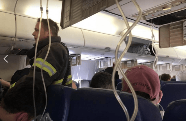 A firefighter on the plane.