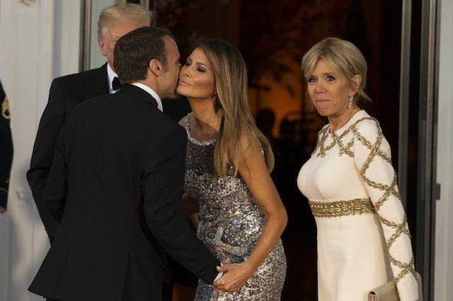 Melania Trump standing with Donald Trump, French President and Brigitte Macron.