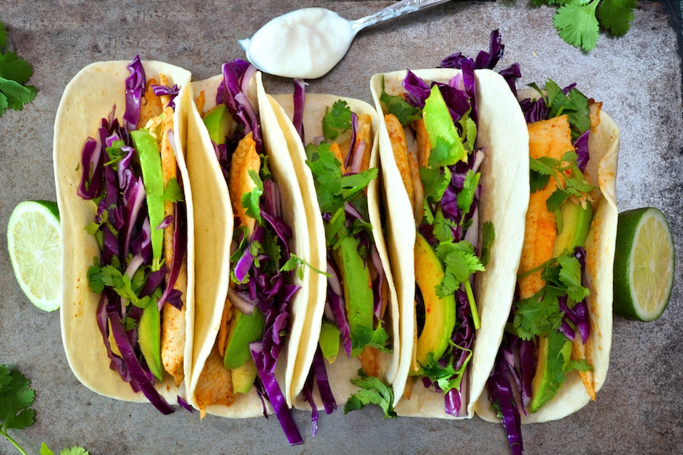 Spicy fish tacos with red cabbage lime slaw and avocado