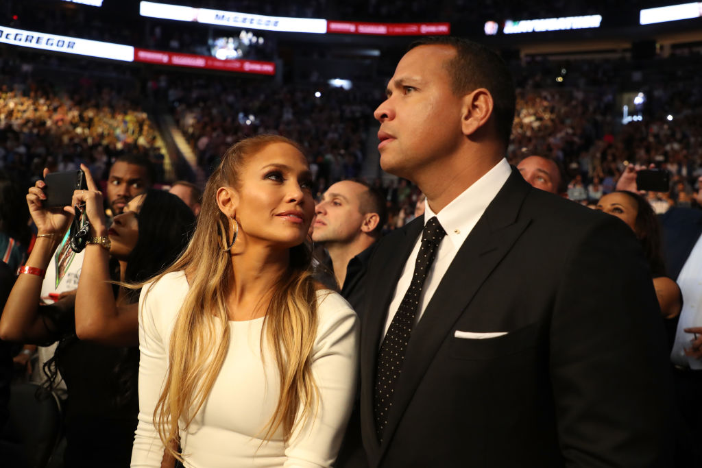 Actress Jennifer Lopez and former MLB player Alex Rodriguez attend the super welterweight boxing match