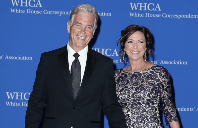 John Roberts and his wife, CNN reporter Kyra Phillips on a red carpet.