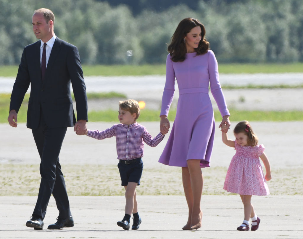 Britain's Prince William, Duke of Cambridge and his wife Kate, the Duchess of Cambridge, and their children Prince George and Princess Charlotte on the tarmac of the Airbus compound in Hamburg
