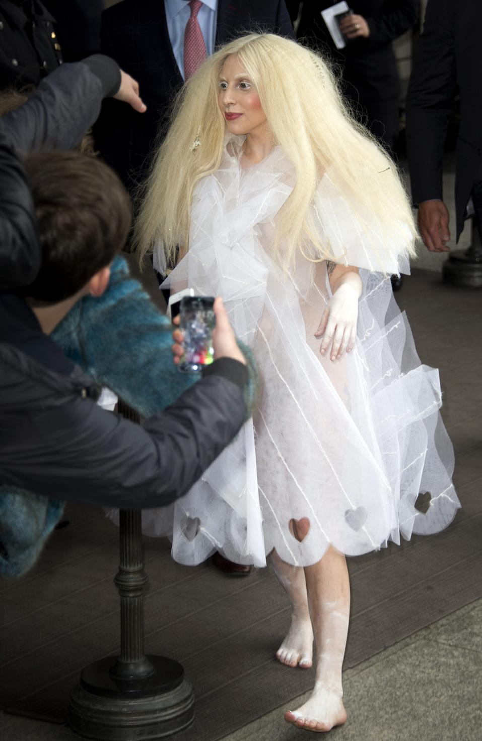 US singer Lady Gaga greet fans as she leaves the Ritz Carlton hotel on Potsdamer Platz in Berlin