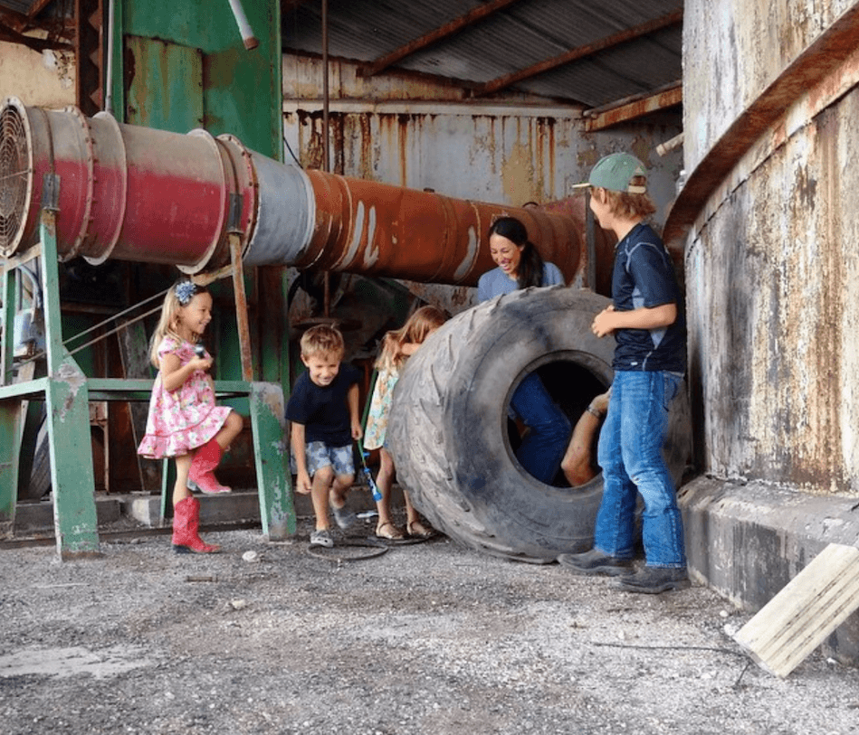 Gaines kids rolling chip in a tire