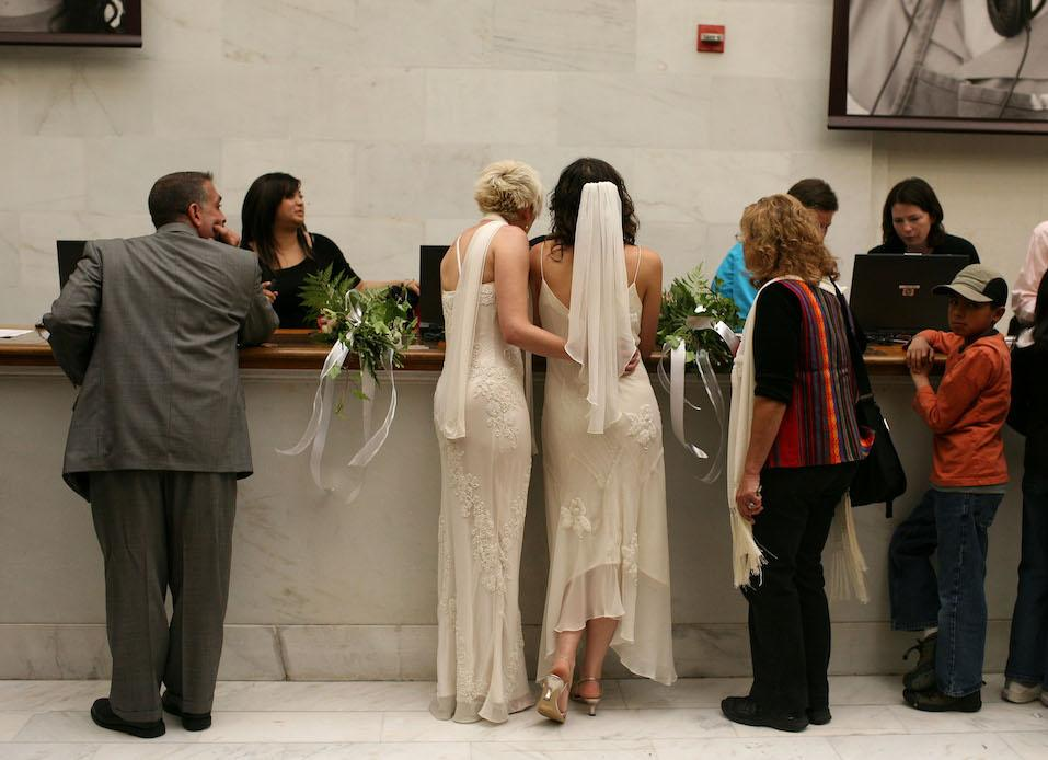 Same-sex couple Amber Weiss and Sharon Papo stand in line to receive their marriage license before getting married