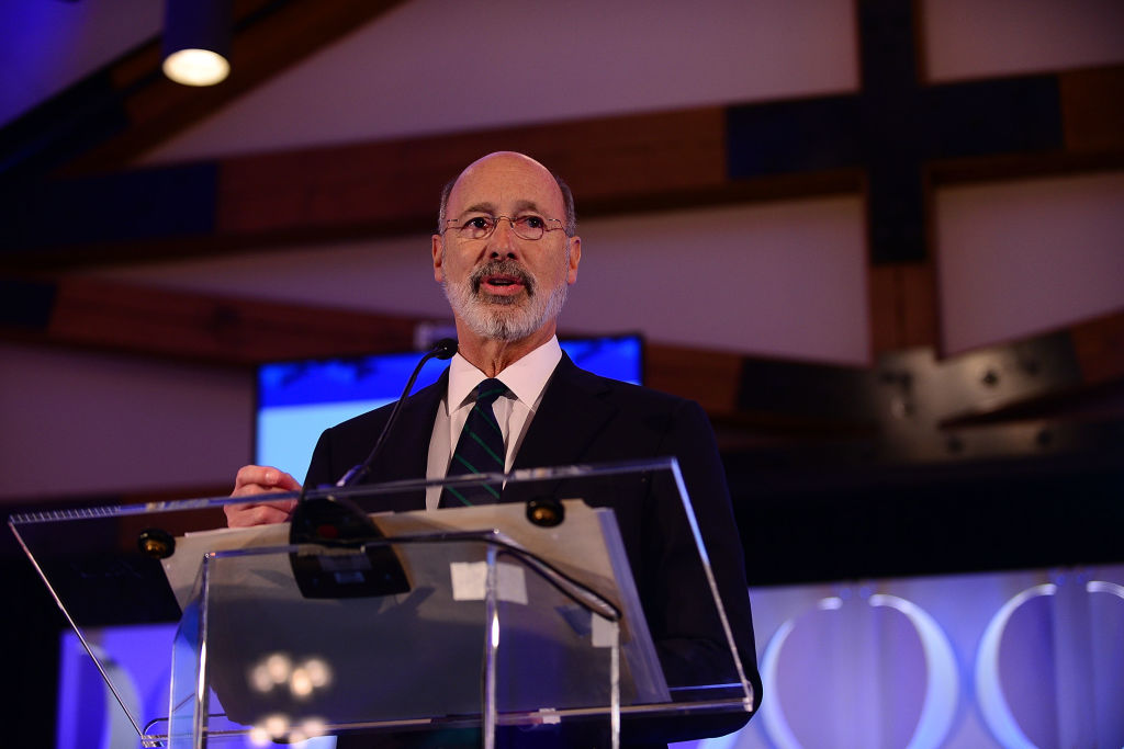 Pennsylvania Gov. Tom Wolf speaks on stage during the Geisinger National Symposium