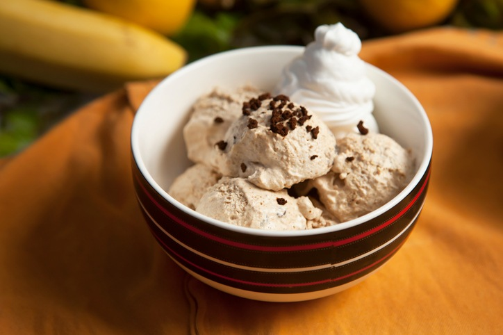 Coffee ice cream with cream in a bowl