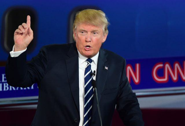 Donald Trump pointing a finger while speaking.
