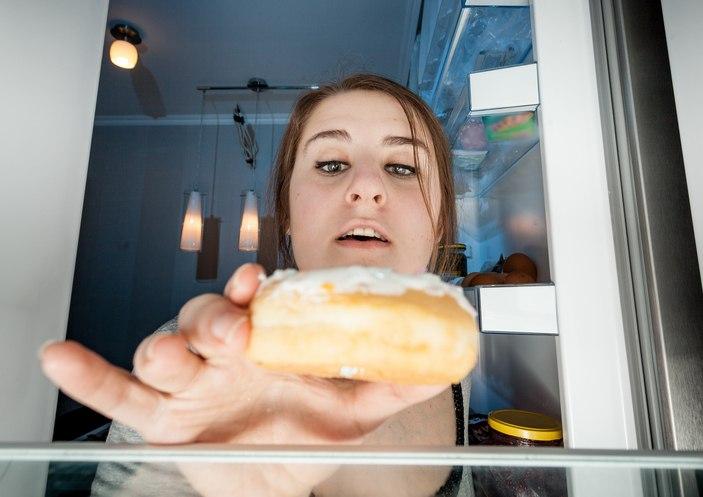 woman with doughnut