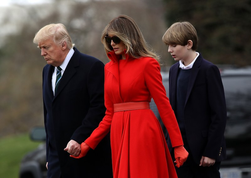 WASHINGTON, DC - MARCH 17: (L-R) U.S. President Donald Trump, First Lady Melania Trump and son Barron Trump prepare to depart the White House on March 17, 2017 in Washington, DC. President Trump is spending the weekend at his Mar-a-Lago estate in Florida. (Photo by Justin Sullivan/Getty Images)
