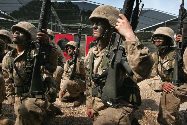 Female United States Marine Corps recruits receive instructions for a training exercise