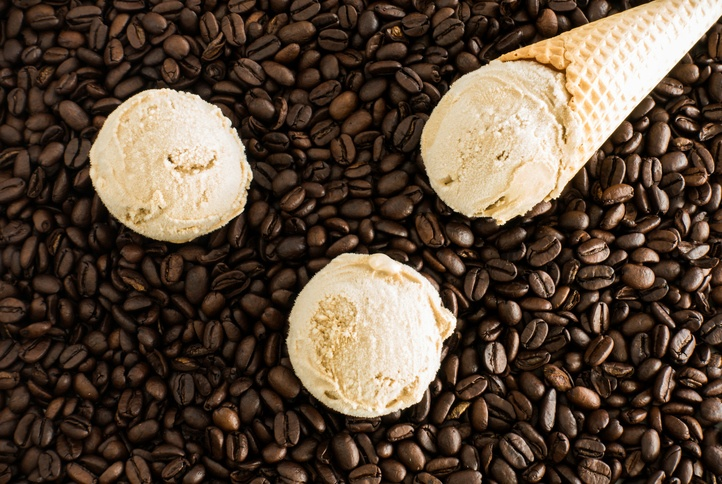 Scoops of Coffee Ice Cream and Cone on Coffee Beans
