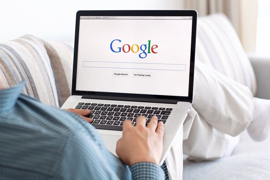 Man searching on Google while on his laptop