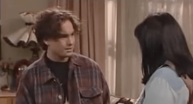 David talking to Roseanne in the living room.