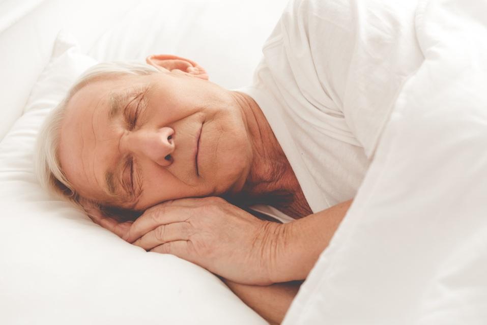 old man sleeping in bed