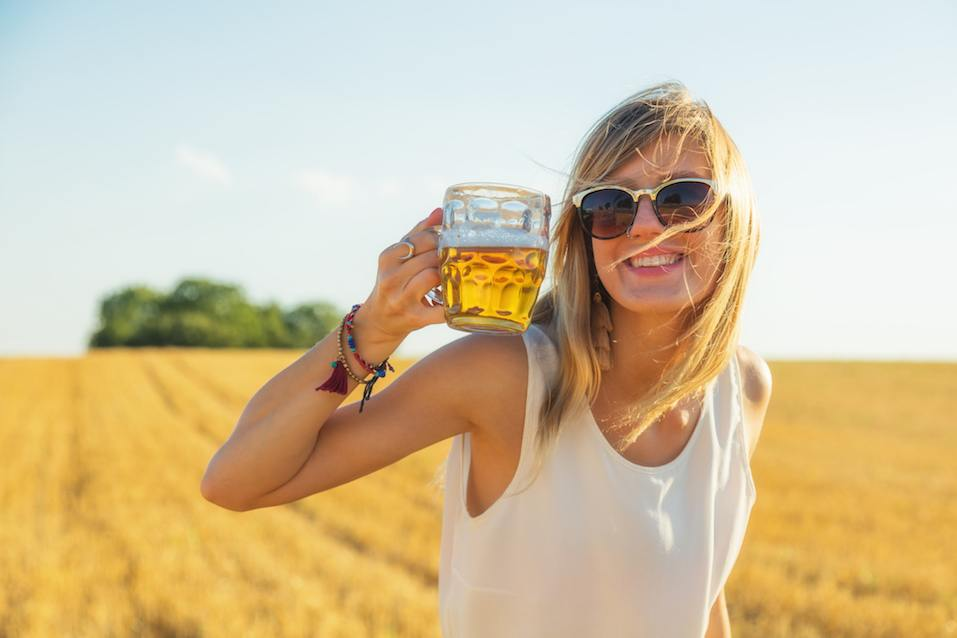 Happy woman holding beer glass
