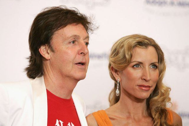 Paul McCartney and Heather Mills on a red carpet together.