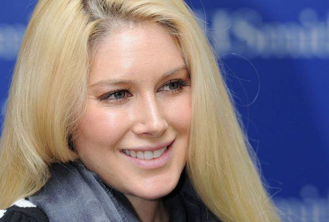 Heidi Montag smiling on a red carpet.