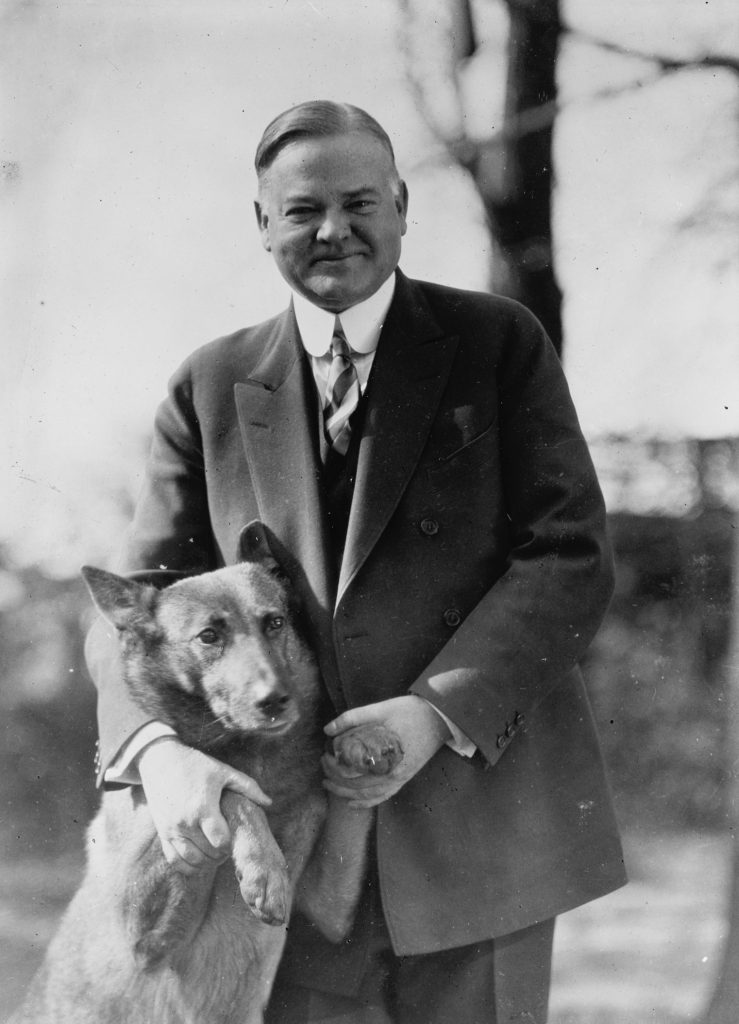 A photo of Herbert Hoover with a dog
