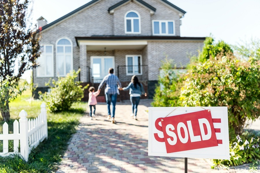Family moving in with sold board