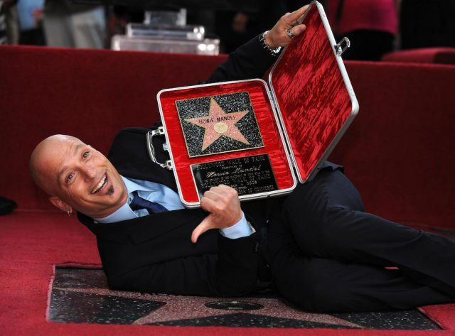 "Howie Mandel, host of TV show ""Deal or No Deal"" on NBC poses after he received a star on the Hollywood Walk of Fame"
