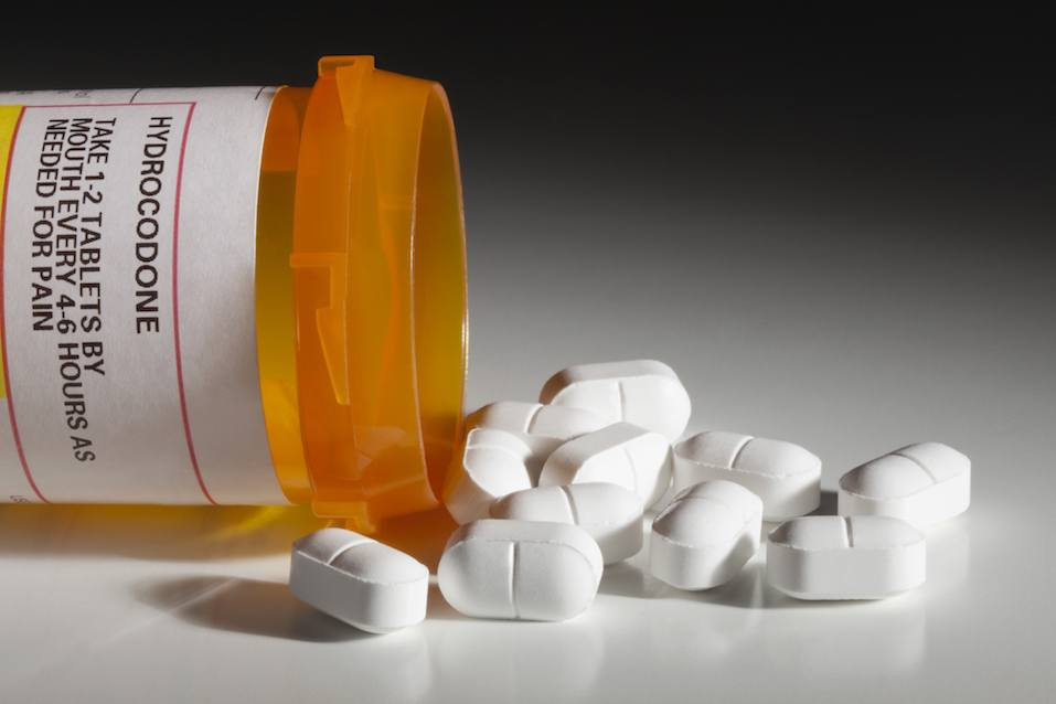hydrocodone tablets spilling out