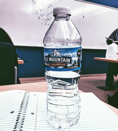 Ice Mountain water bottle on a desk.