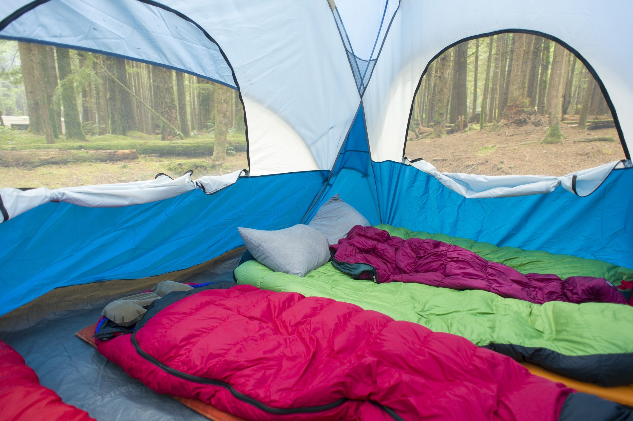 The interior of a tent with multiple sleeping bags
