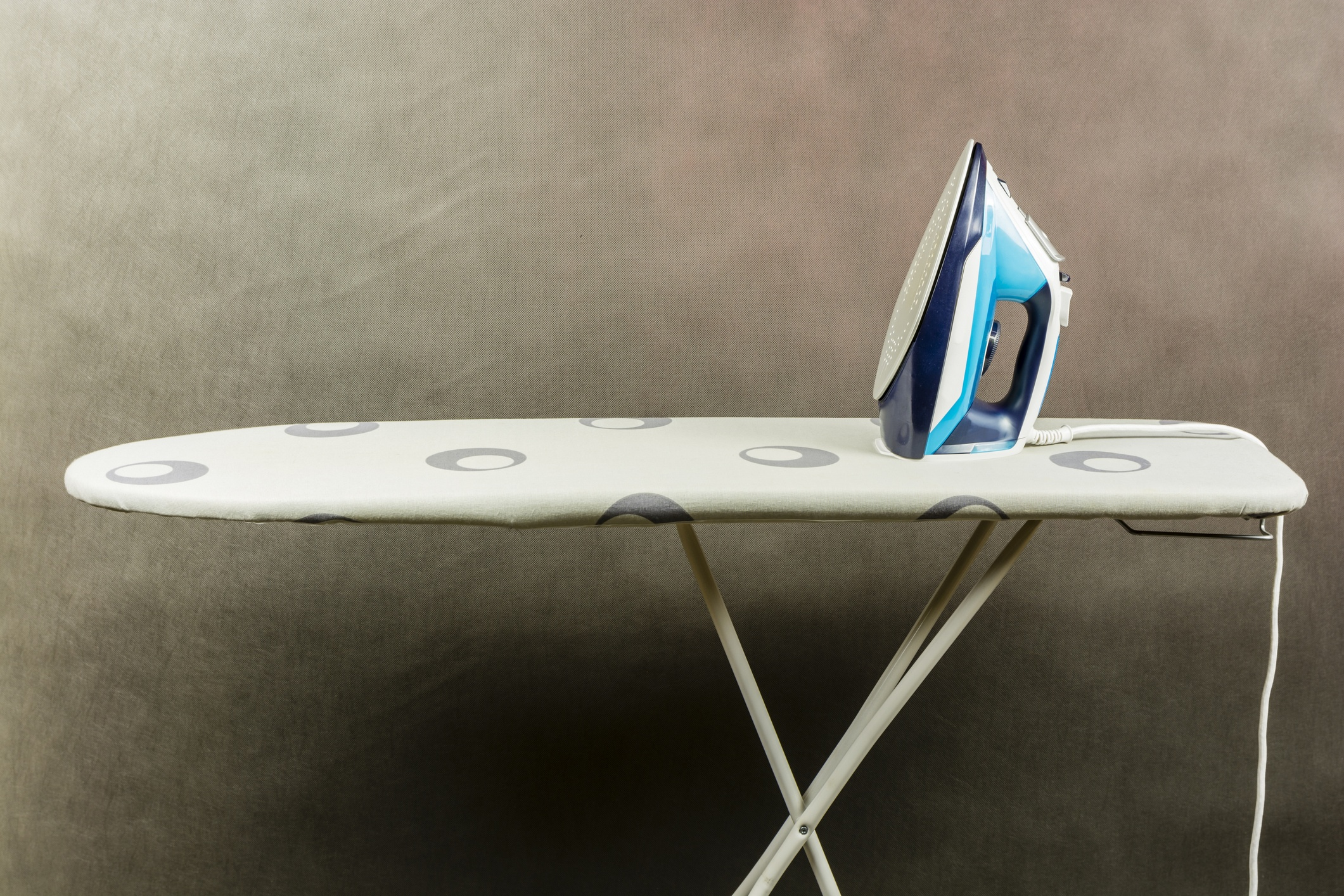 Clothes iron on the ironing board.