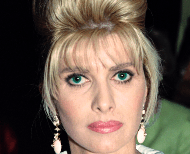 Ivana Trump wearing large earrings while posing for a photograph.