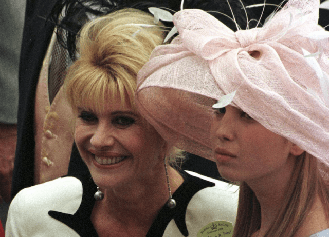 Ivana smiling as she stands next to Ivanka.