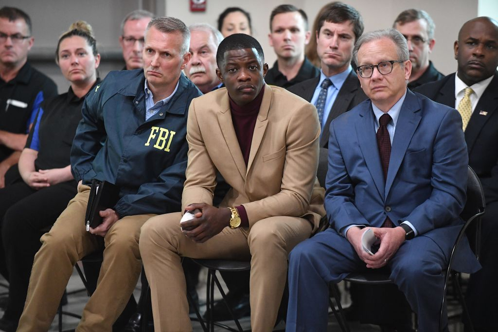 Waffle House patron James Shaw, Jr. (C) who stopped the shooting at a Waffle House where a gunman opened fire killing four and injuring two attends a press conference with FBI Special Agent In Charge, Matthew Espenshade (L) and Metro Nashville Mayor David Briley (right) on April 22, 2018 in Nashville.