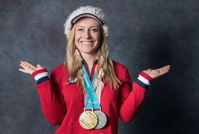 Jamie Anderson posing with her medals.