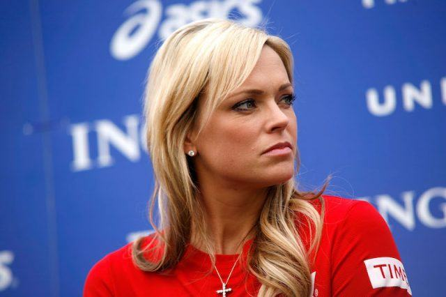 Jennie Finch sits during a press panel.