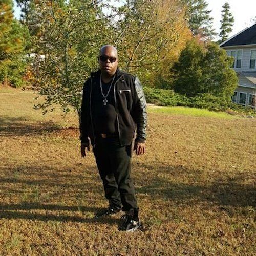 Jermaine Hopkins standing in front of a lawn.