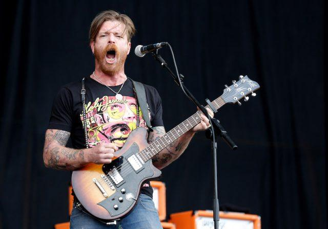Jesse Hughes performing while in concert.