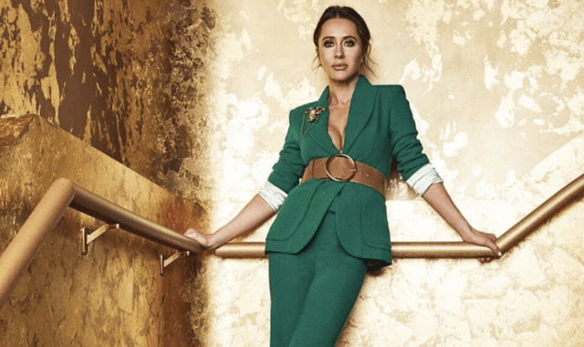 Jessica Mulroney posing in a green suit.