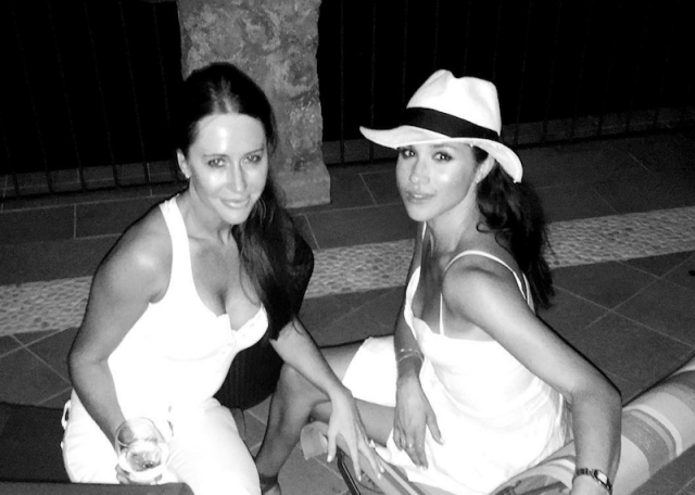Jessica Mulroney and Meghan Markle posing together.