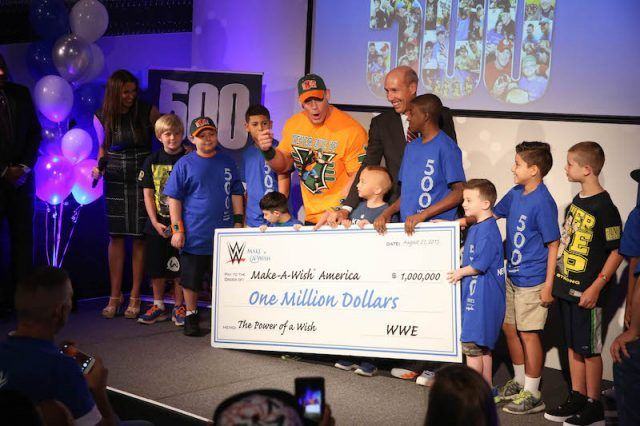 John Cena standing at an event with the Make-a-Wish Foundation.