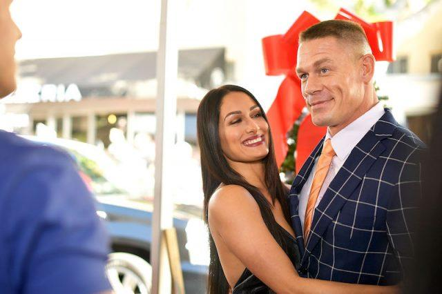 Nikki Bell and John Cena posing together at an event.