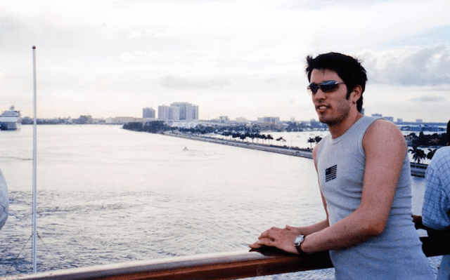 Jonathan Scott in front of a river.
