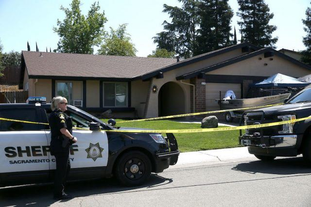 A police woman stands in front of DeAngelo's home.