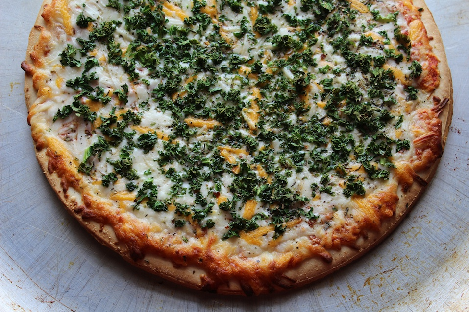 Pizza covered in fresh kale