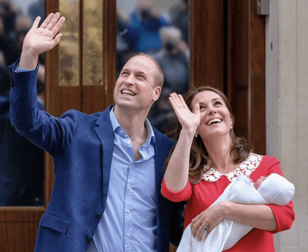 Prince William and Kate Middleton waving upwards.