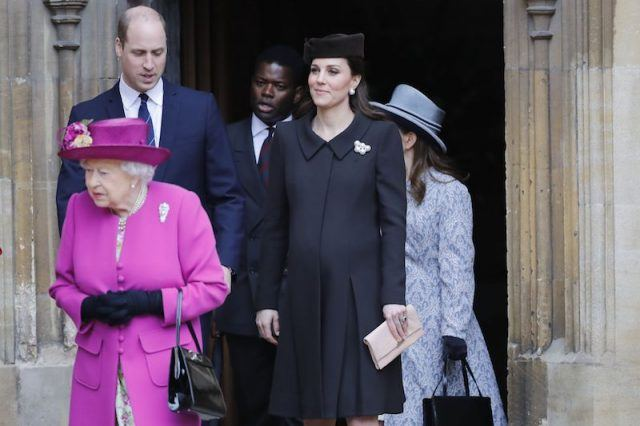 Kate Middleton walks alongside the queen and Prince William.