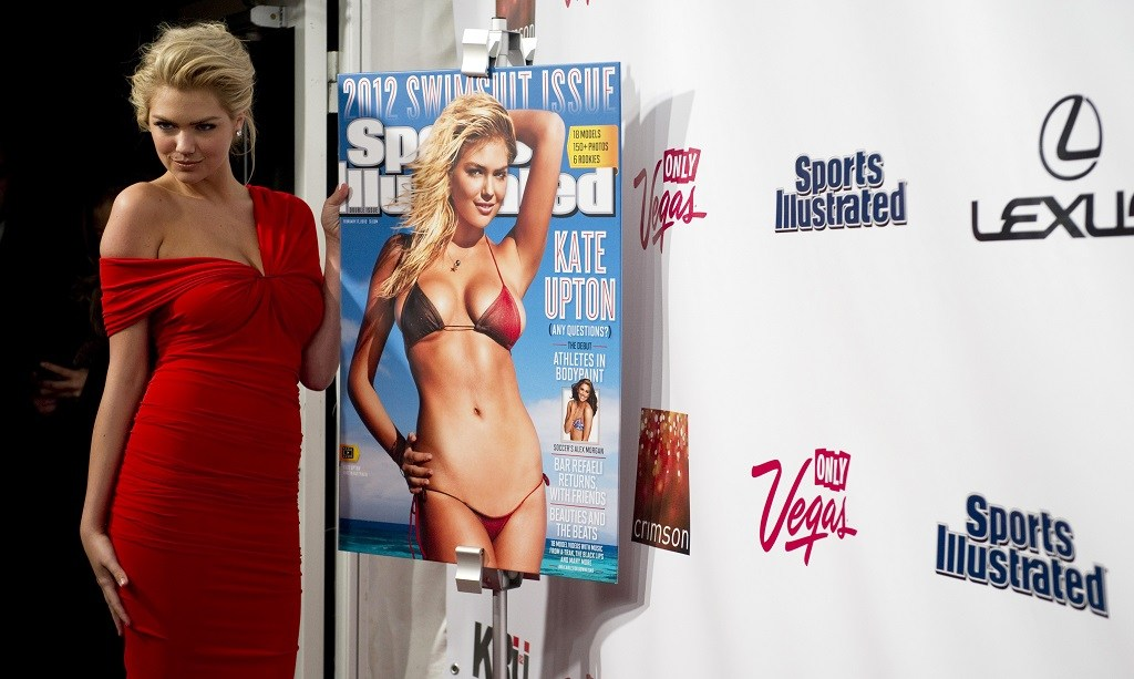 Model Kate Upton poses for photos during an event to promote the 2012 Swimsuit Issue of Sports Illustrated.