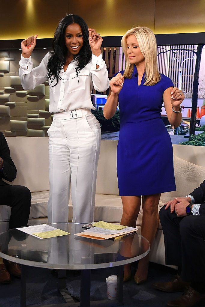 "Singer Kelly Rowland (L) and co-host Ainsley Earhardt dance during ""Fox And Friends"""