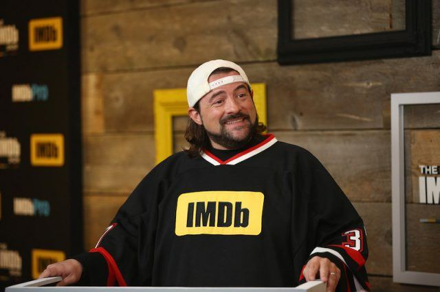 Kevin Smith smiling while speaking to a crowd.